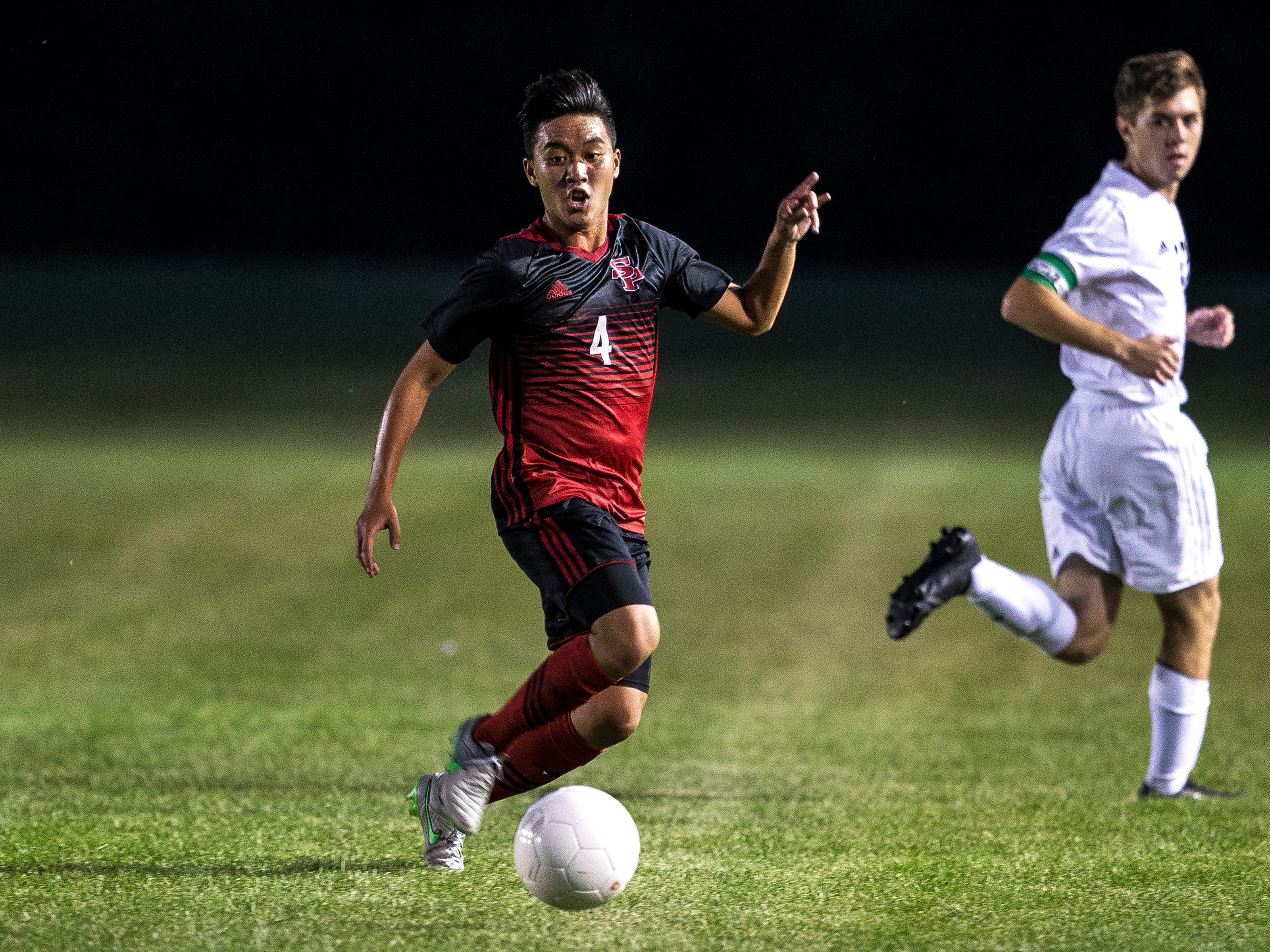 SPASH player Yia Yang moves the ball down field during a soccer game between SPASH and D.C. Everest in Stevens Point, Wis., September 13, 2018.