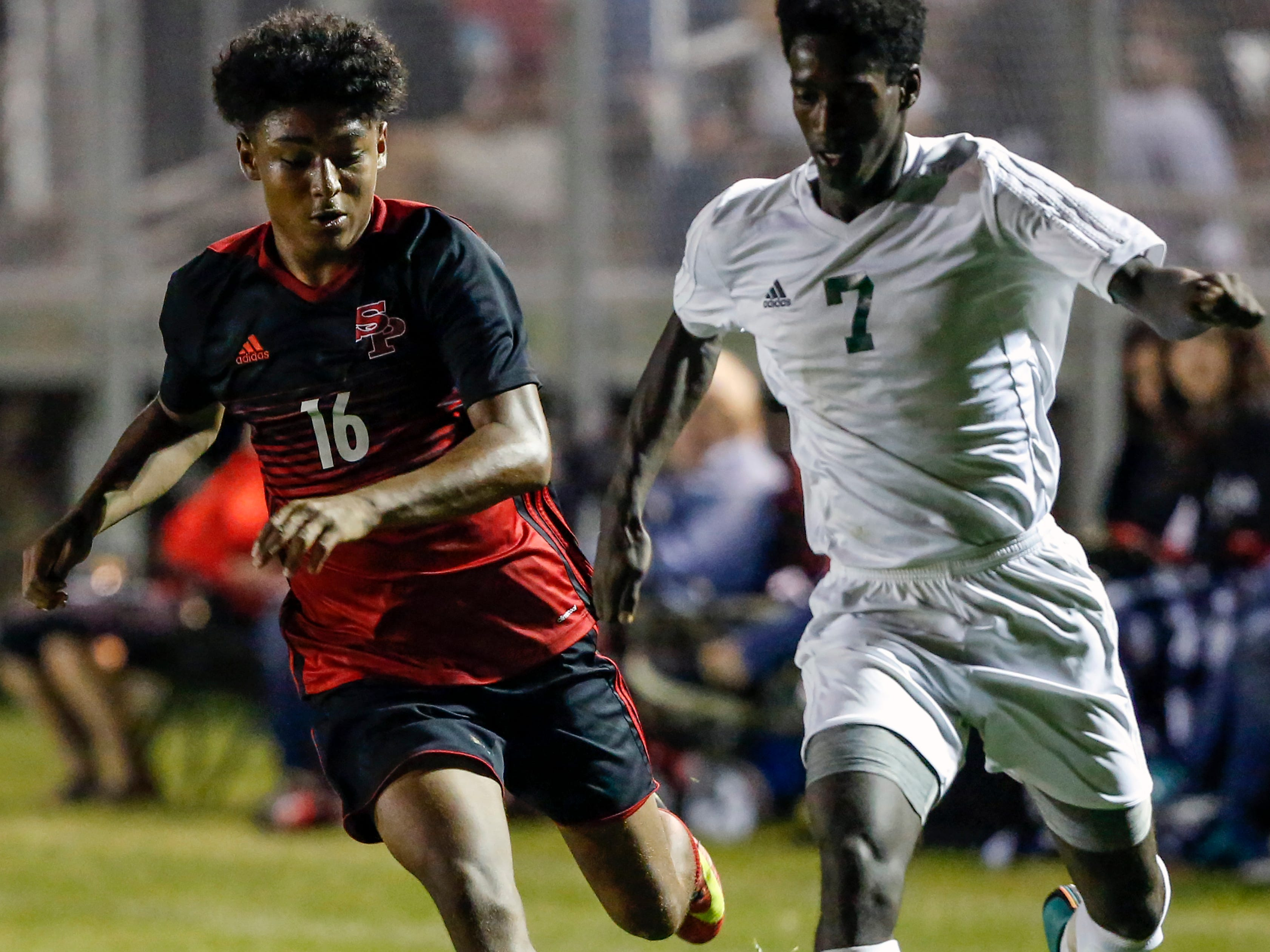 SPASH player Lio Perkins chases D.C. Everest player Tamirat Knutson during a soccer game between SPASH and D.C. Everest in Stevens Point, Wis., September 13, 2018.