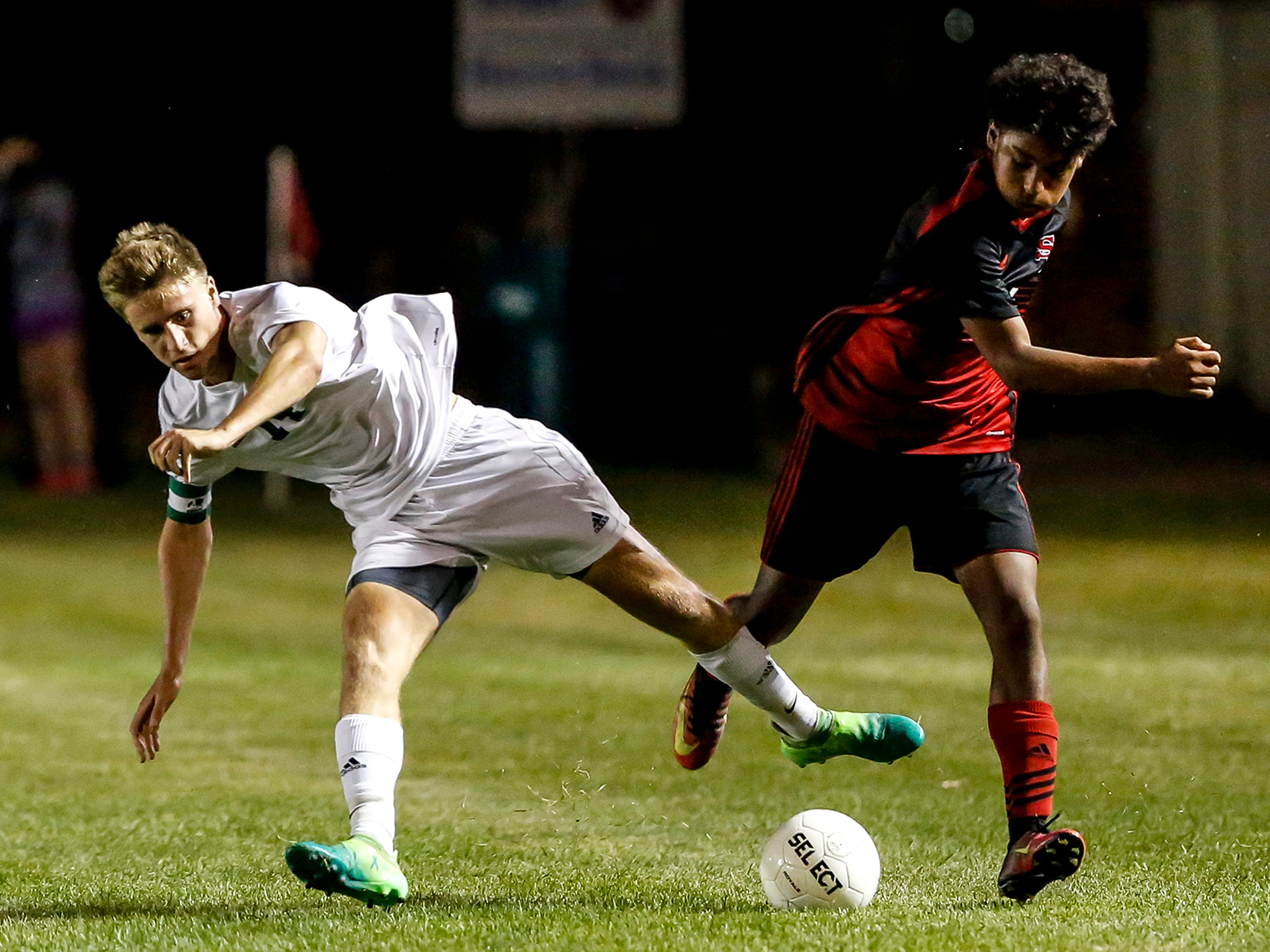 Ethan Stashek of D.C. Everest and Lio Perkins collide while fighting for possession during a soccer game between SPASH and D.C. Everest in Stevens Point, Wis., September 13, 2018.