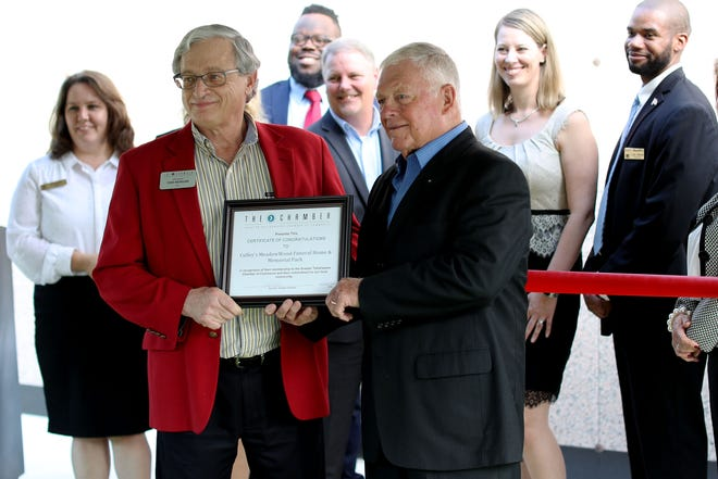 Walter Culley receiving a certificate from the Tallahassee Chamber of Commerce  during the 115 year Culley's Funeral Home celebration.