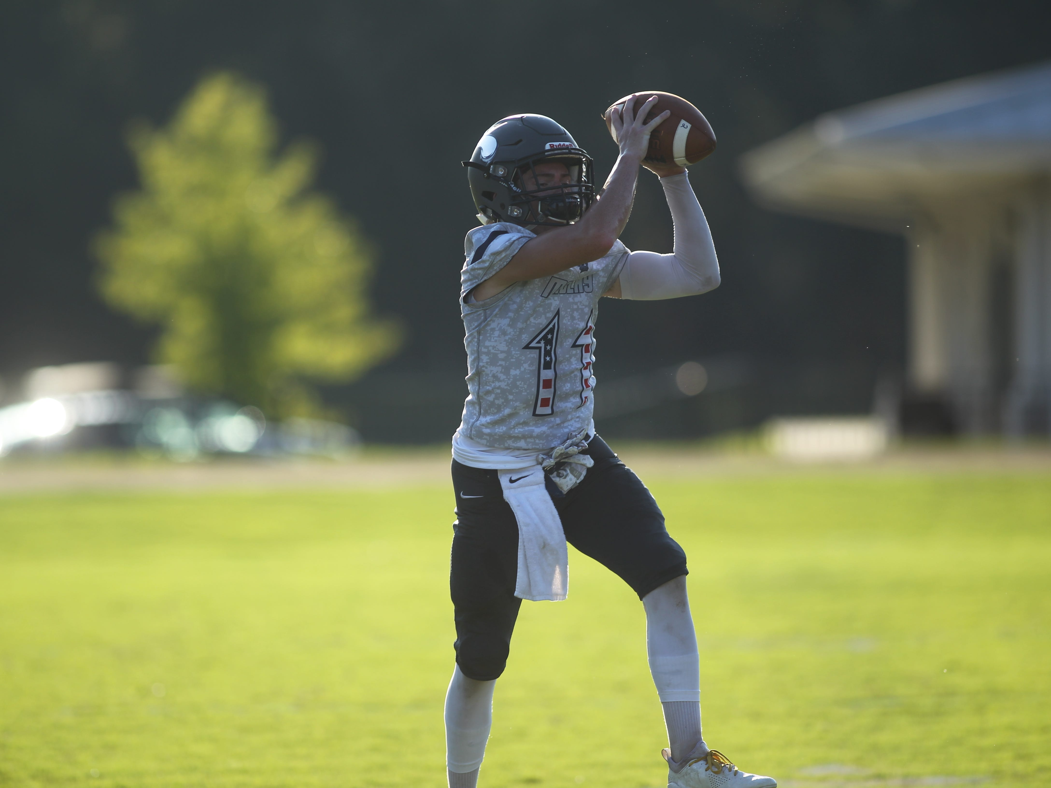 Munroe and Maclay warm-up prior to Friday's football game between the two small schools.