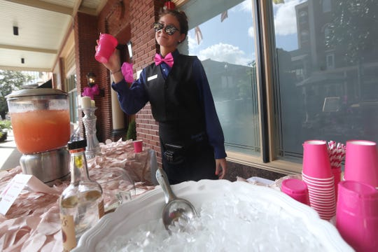 Daniele Thomas sells pink lemonade outside of the Governor's Club, part of Breast Cancer Awareness Month in 2017.