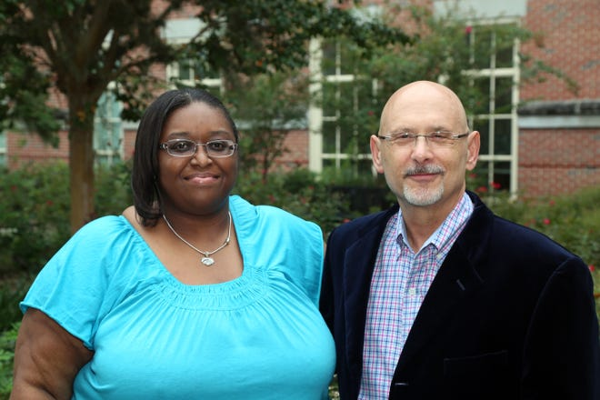 Tomeka Norton-Brown, project coordinator for ACTS 2, and Rob Glueckauf, professor in the FSU College of Medicine's Department of Behavioral Sciences and Social Medicine work with churches on respite care.