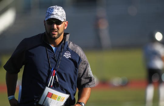Maclay football coach Lance Ramer watches his team during pregame before a game against Munroe.