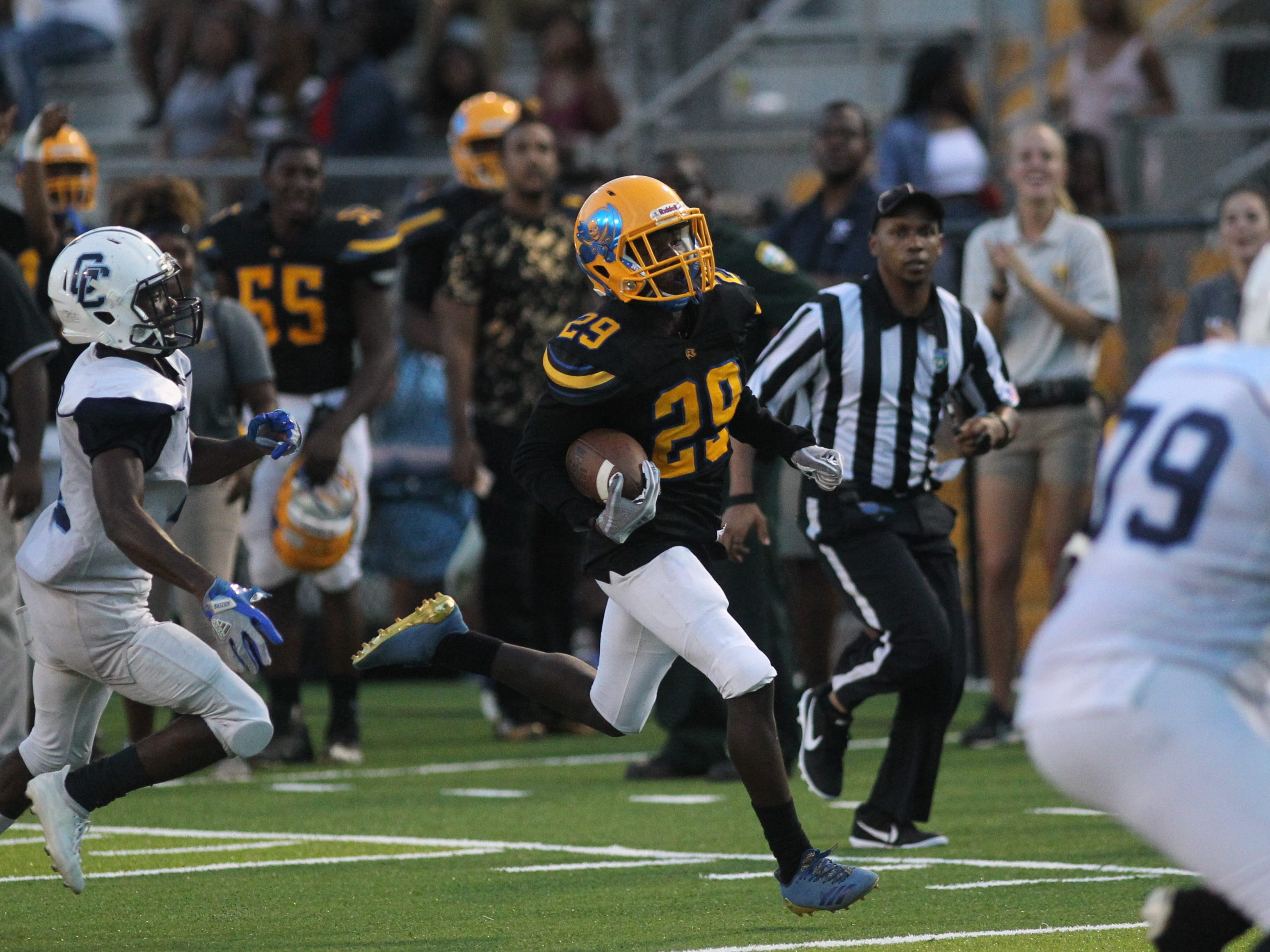 Kameron Bell returns an interception to the 4-yard line to set up a touchdown as Rickards beat Gadsden County 55-32 at Gene Cox Stadium on Thursday, Sept. 13, 2018.