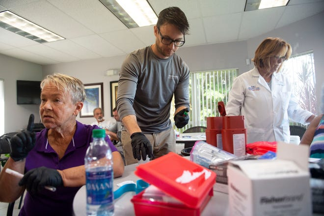 "Florida Atlantic University's Harbor Branch Oceanographic Institute researchers (from left) Chris Campbell, volunteer RN, Adam Schaefer, epidemiologist, and Dr. Kathi Harvey, of Harbor Branch and the FAU College of Nursing, collect blood, urine and nasal swab samples Friday, Sept. 14, 2018, at the Florida Sportsman magazine office in Stuart. The group is testing people who live and work around blue-green algae blooms in the St. Lucie River and have found detectable levels of the toxin microcystin in the noses of over 70 people tested. ""Preliminary results suggest that microcystin is definitely airborne,"" Schaefer said. Schaefer, the lead researcher on the project, hopes to test people who have not been exposed to algae for a control group and to expand the testing to Lake Okeechobee and Florida's West Coast, but more funding is necessary to collect the data needed for a long-term study on microcystin exposure."