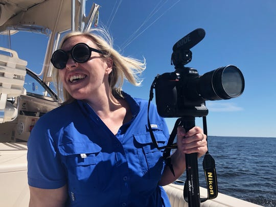Visuals journalist Leah Voss on assignment for the Florida Voices project on Sept. 12, 2018, in Pensacola Bay.