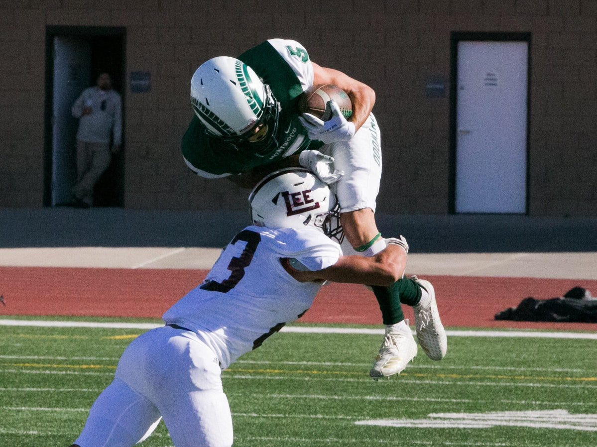Montwood's Ivan Vilchis, 5, is tackled in mid-air. Midland Lee led 21-0 late in the second quarter