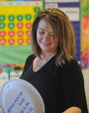 Katrina Madden, the manager of special education at the Oxnard School District, checks out a Therapeutic Learning Classroom at Christa McAuliffe. The rooms are designed with things like fidget bands attached to the front of the desks so students with wiggly feet have someplace to channel their energy.
