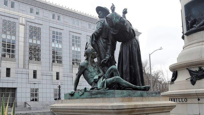 This March 2 photo shows a statue that depicts a Native American at the feet of a Spanish cowboy and Catholic missionary in San Francisco. A San Francisco board has decided to remove the 19th-century statue that activists say is racist and demeaning to indigenous people.