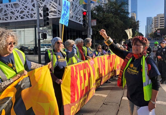 "Members of the group 1000 Grandmothers protest outside the Moscone Center in San Francisco, where the Global Climate Action Summit is being held, on Thursday. The group, which says it is made up of older women activists working to address the climate crisis, chanted ""Listen to your Grandma, no more fracking!"""