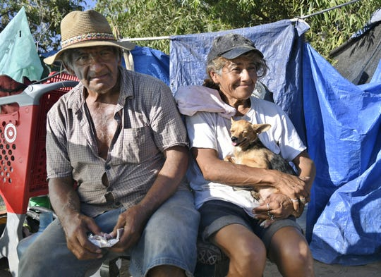 Ernie Sausedo and Jeannie Sandoval relocated their encampment.