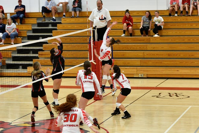 Paige Schroeder of Pacelli Catholic gets the game-winning kill.