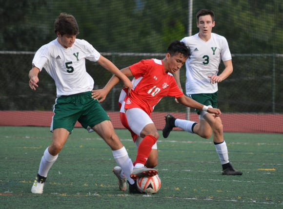Tappan Zee's Jorge Umana (10) makes a move on Yorktown's Jack Prybylishi.