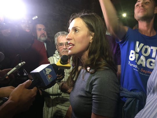 Alessandra Biaggi speaks with reporters at the Bronx Ale House, Sept. 13, 2018, after defeating Sen. Jeff Klein in a Democratic primary.