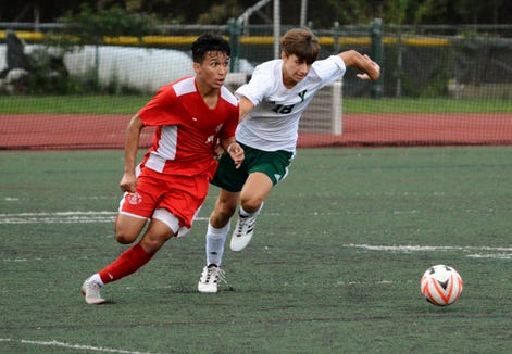 Tappan Zee forward Jorge Umana surveys the field while Yorktown defender Anthony Granitto attempts to stay attached during the second half of a 2-0 win by the Dutchmen.