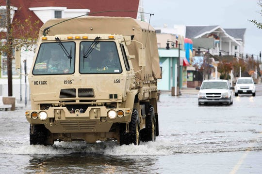 A National Guard vehicle rolls through the streets of Bethany Beach as Superstorm Sandy moves through Delaware on Tuesday, Oct. 30, 2012.