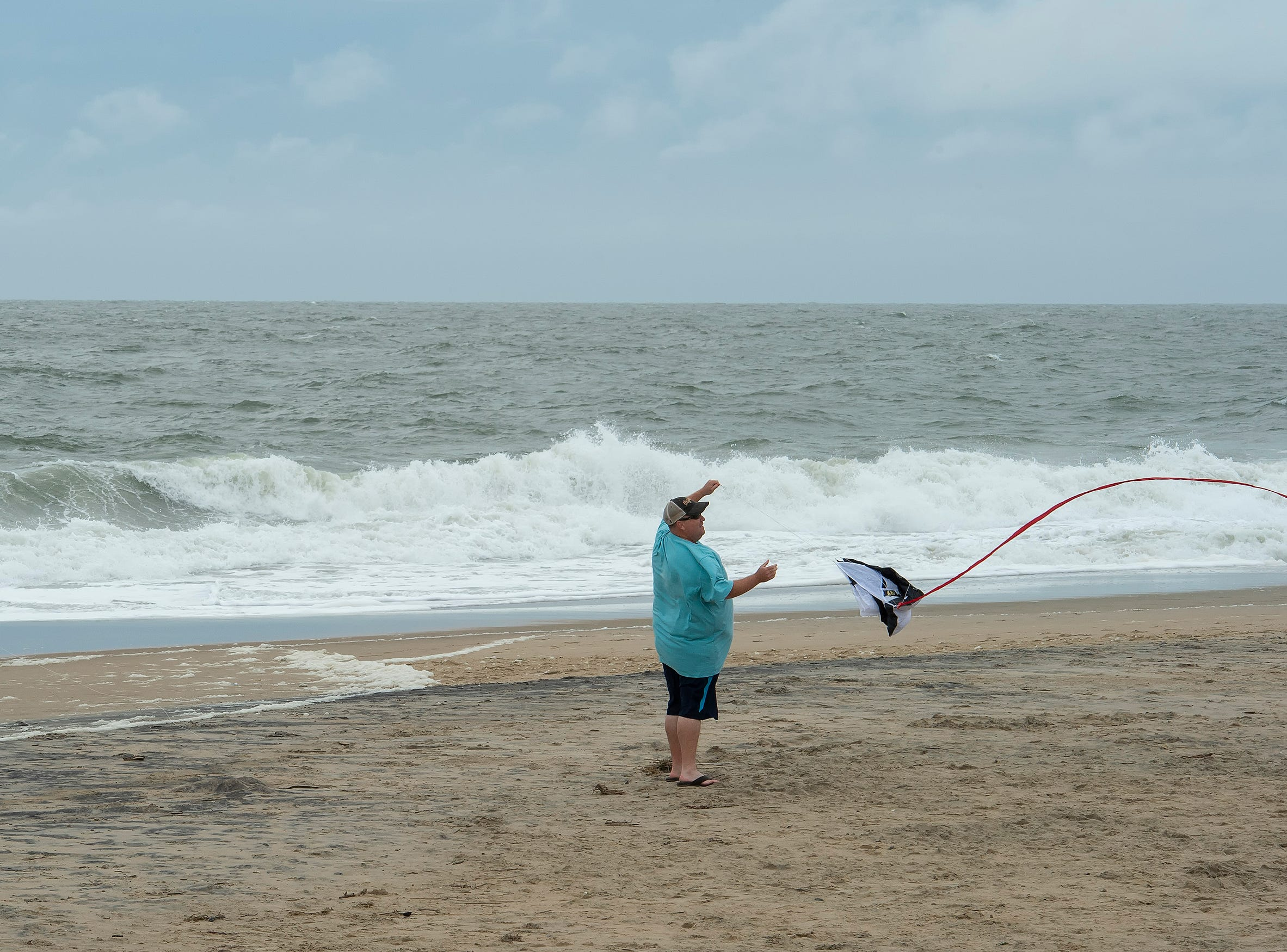 Tyson Hess and his daughter, Kate (10), of Leesburg, Va., fly a kite on the beach at Bethany Beach after Hurricane Florence made landfall in North Carolina.