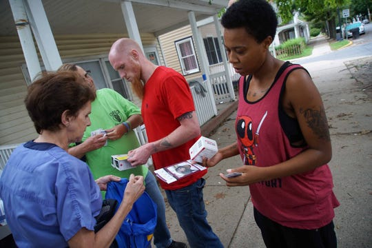 Dr. Sandra Gibney hands out naloxone, the overdose-reversing medication, to members of the Dover community along S. Governors Avenue to help reduce overdose deaths.