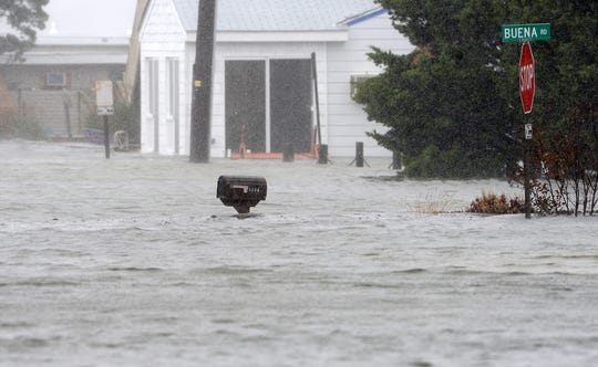 Water is up to the mail boxes on Read Street in Dewey Beach as flooding from the bay comes in during Hurricane Sandy in 2012.