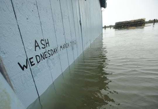 Flood water from Hurricane Sandy creeps up on the Ash Wednesday Storm of 1962's mark at the oyster house in Bayford, Va. on Sunday morning, Oct. 28, 2012. Areas on the Chesapeake Bay side of Virginia's Eastern Shore are already experiencing the coastal flooding effects of the storm.