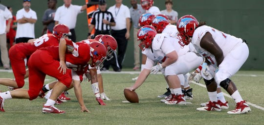 Sweetwater's defense lines up against Hirschi Thursday, Sept. 13, 2018, at Memorial Stadium. The Huskies defeated the Mustangs 51-7.