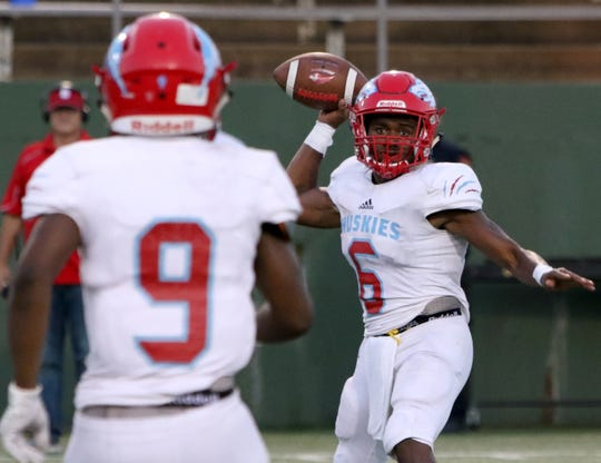 Hirschi's Nathan Downing passes to Tian Harrell in the game against Sweetwater Thursday, Sept. 13, 2018, at Memorial Stadium. The Huskies defeated the Mustangs 51-7.