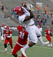 Hirschi's Daimarqua Foster catches the pass from Nathan Downing in the game against Sweetwater Thursday, Sept. 13, 2018, at Memorial Stadium. The Huskies defeated the Mustangs 51-7.