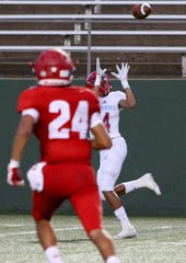 Hirschi's Isaiah Wilson catches the touchdown pass from Nathan Downing against Sweetwater Thursday, Sept. 13, 2018, at Memorial Stadium. The Huskies defeated the Mustangs 51-7.
