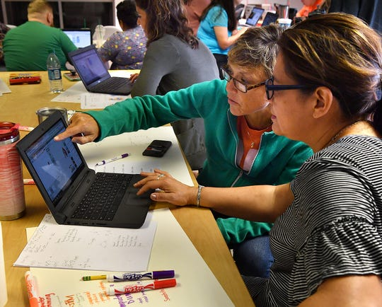 Clarisa Richie, left, and Veronica Snell of Fain Elementary work out a coding algorithm during a STEAM 3.0 training session at Dexter Learning.