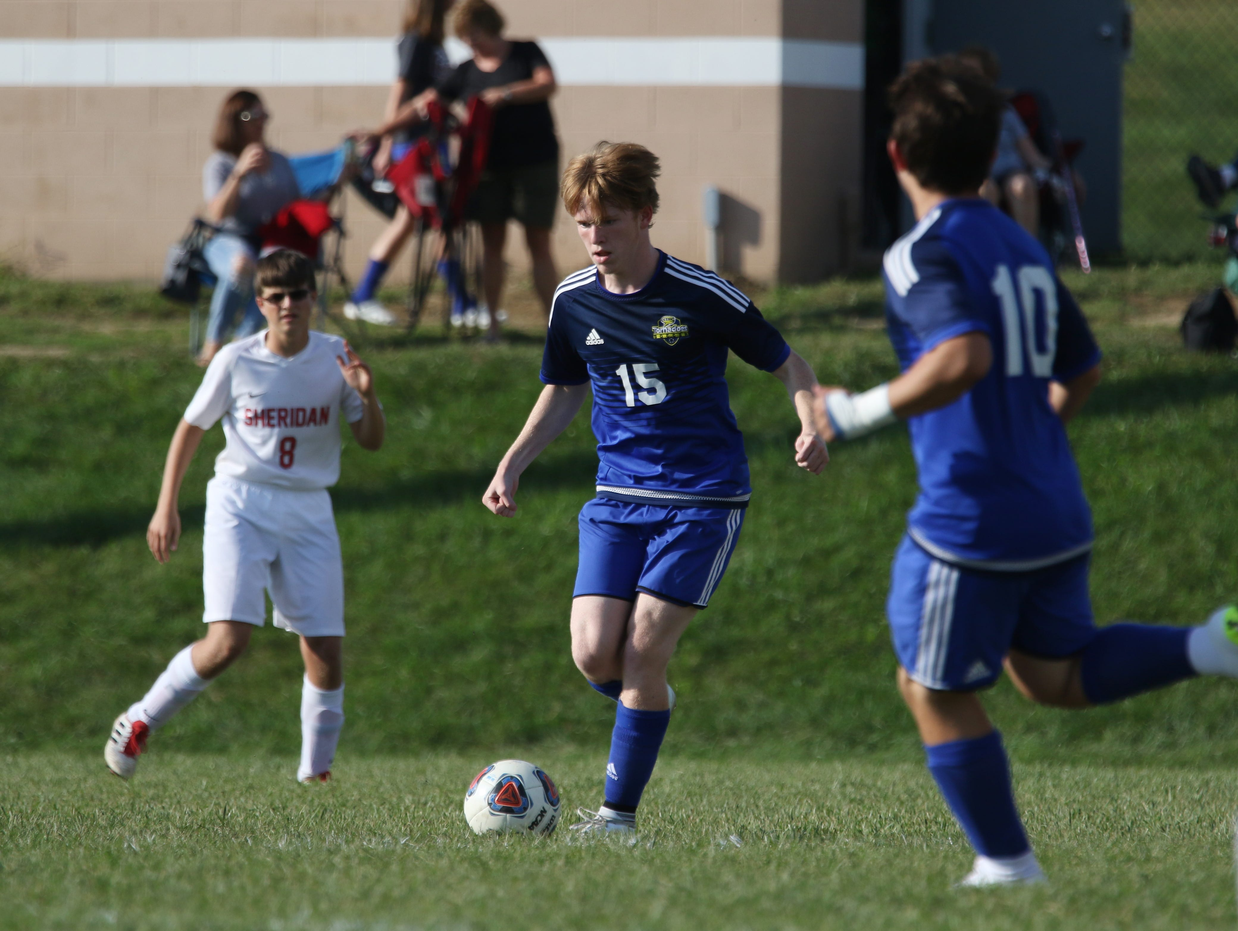 West Muskingum's Jonathan Petty moves with the ball against Sheridan.