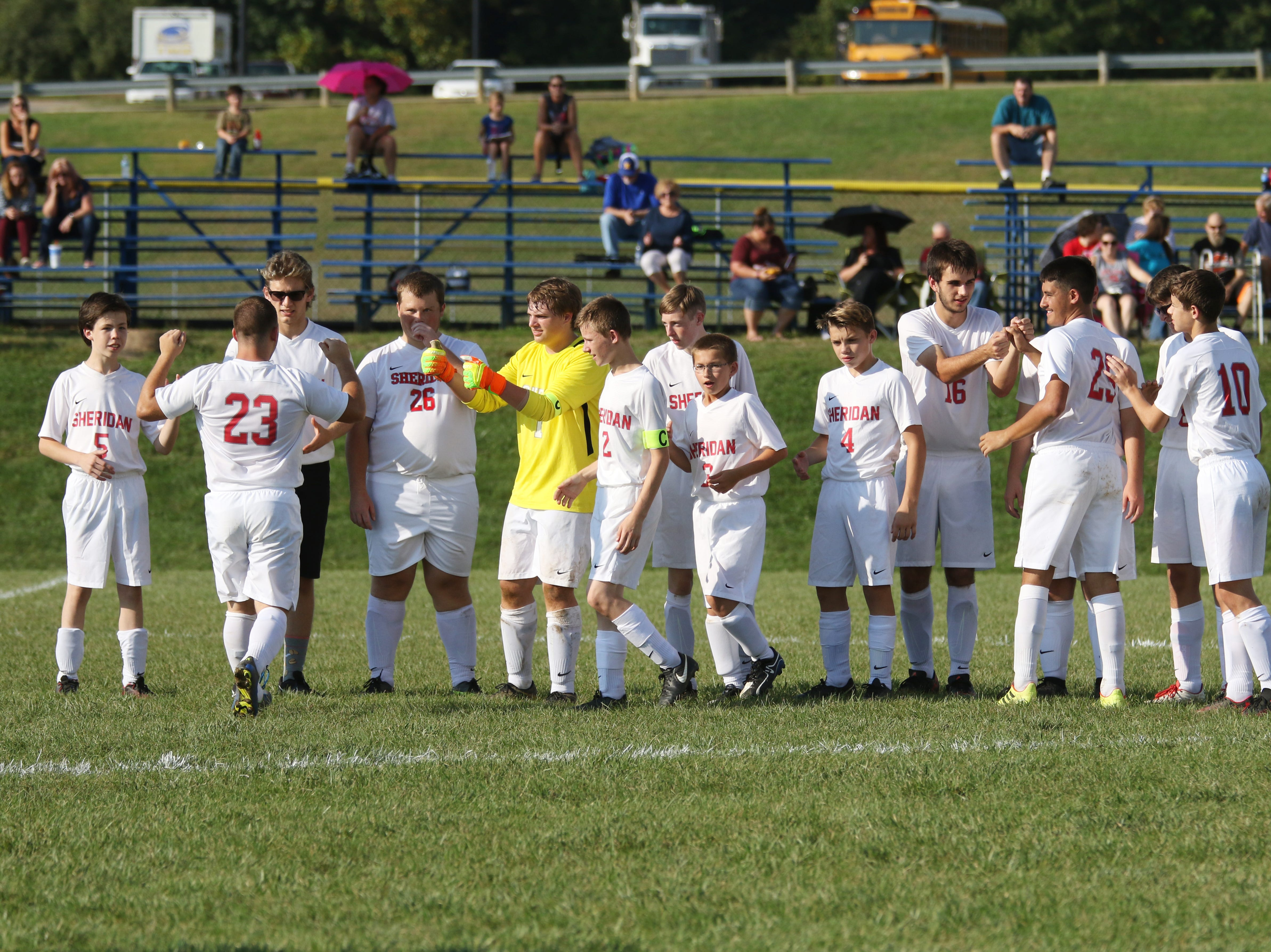 Sheridan meets on the field during introducations before taking on West Muskingum.