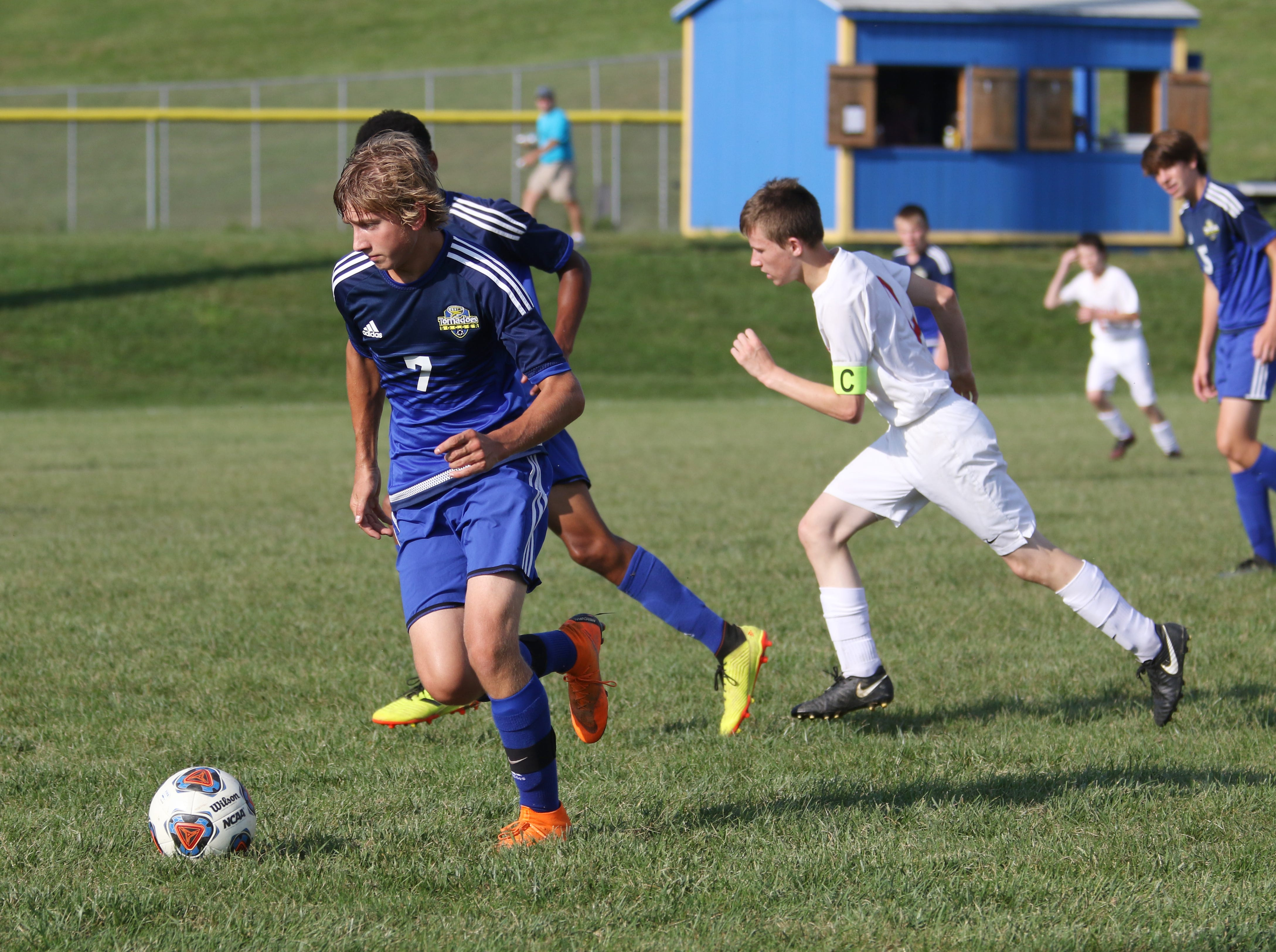 West Muskingum's Cayden Porter moves with the ball against Sheridan.