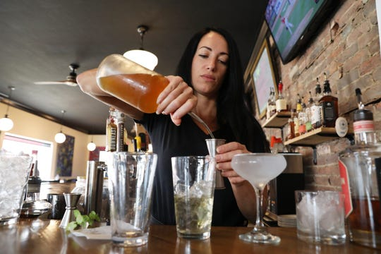 Co-owner Jessica Strong pours a cocktail at Strong and Company in Somerset.