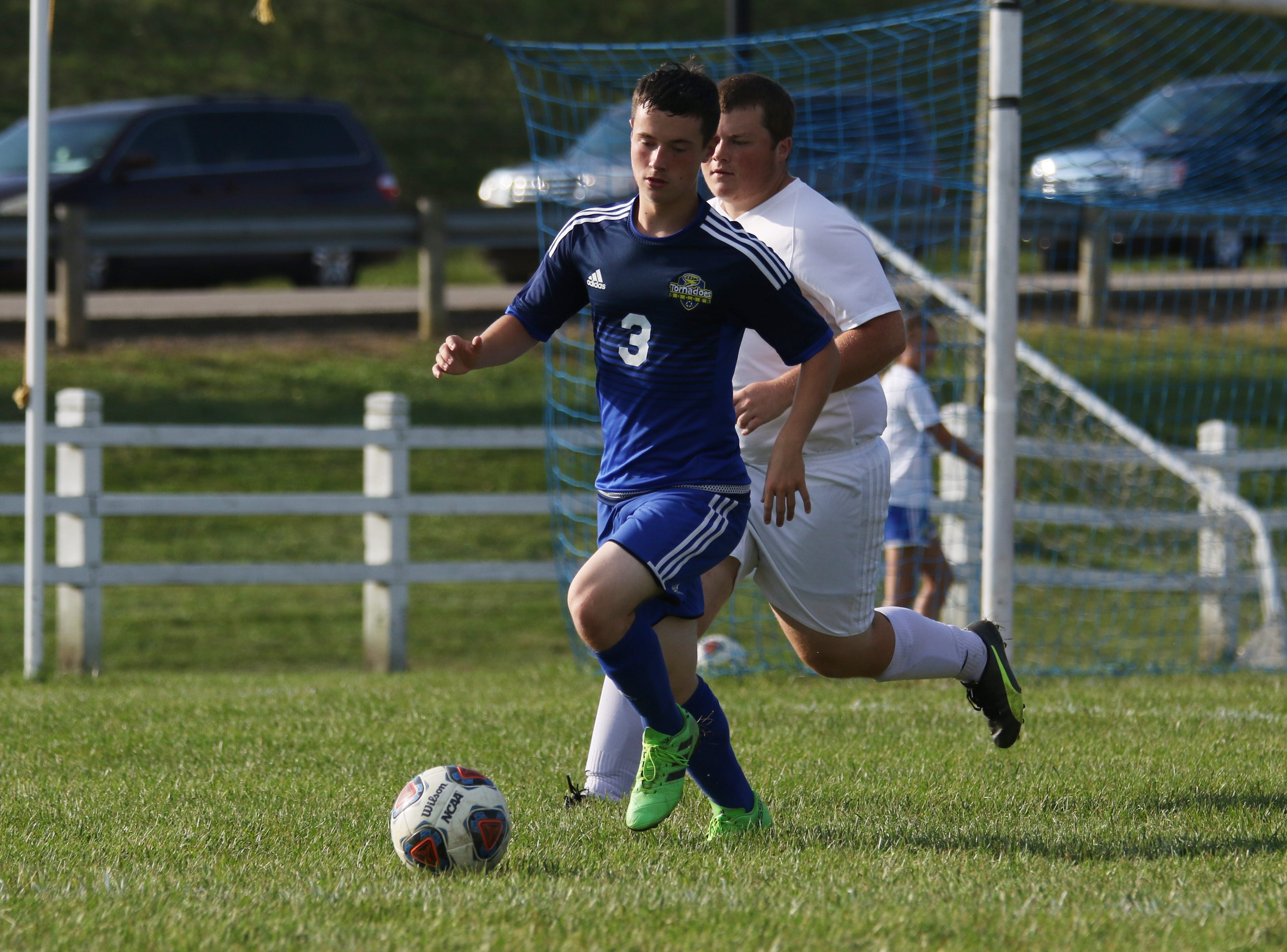 West Muskingum's Brandon Latier moves with the ball against Sheridan.