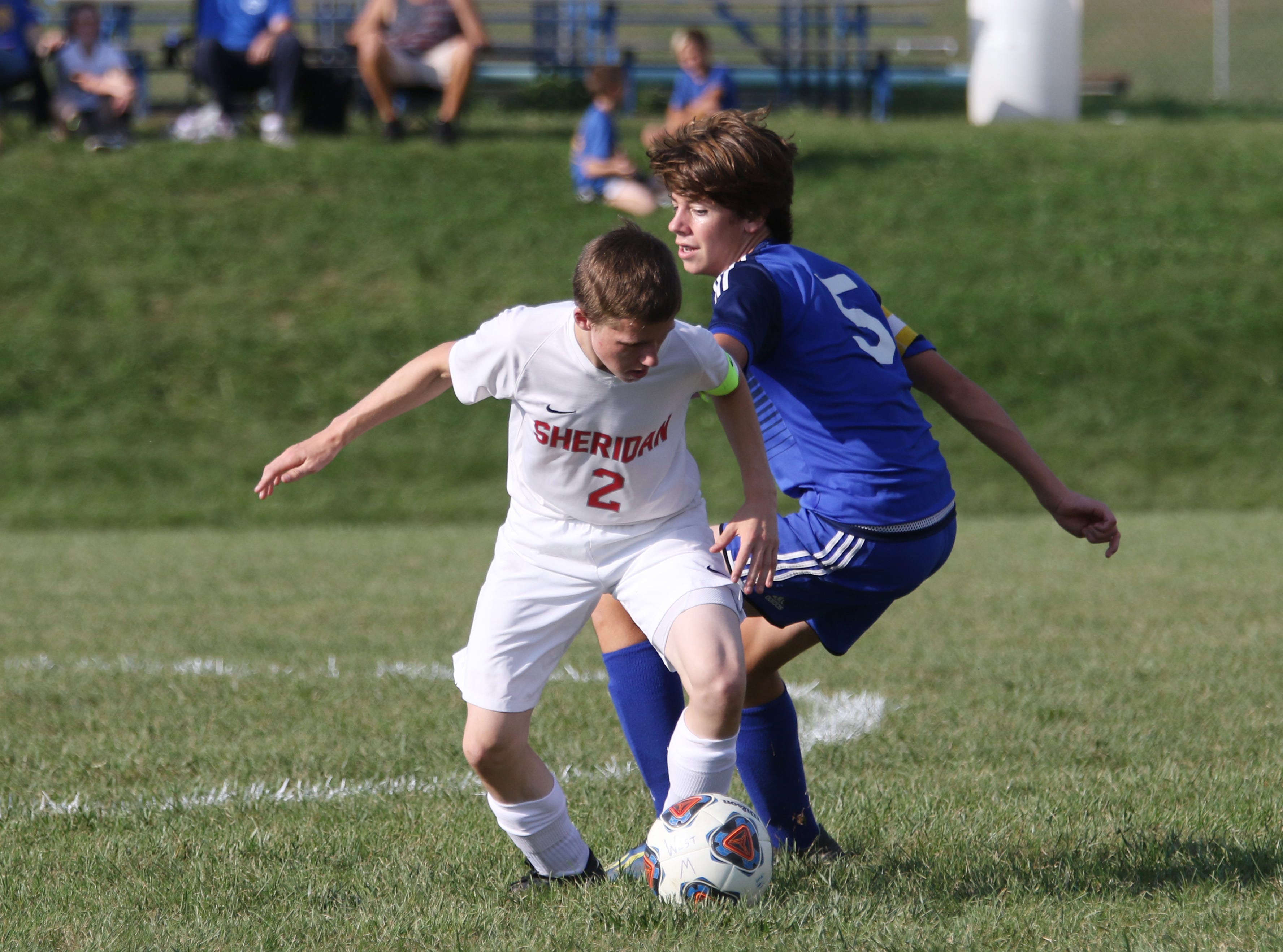 Sheridan's Jacob Rock moves with the ball against West Muskingum.