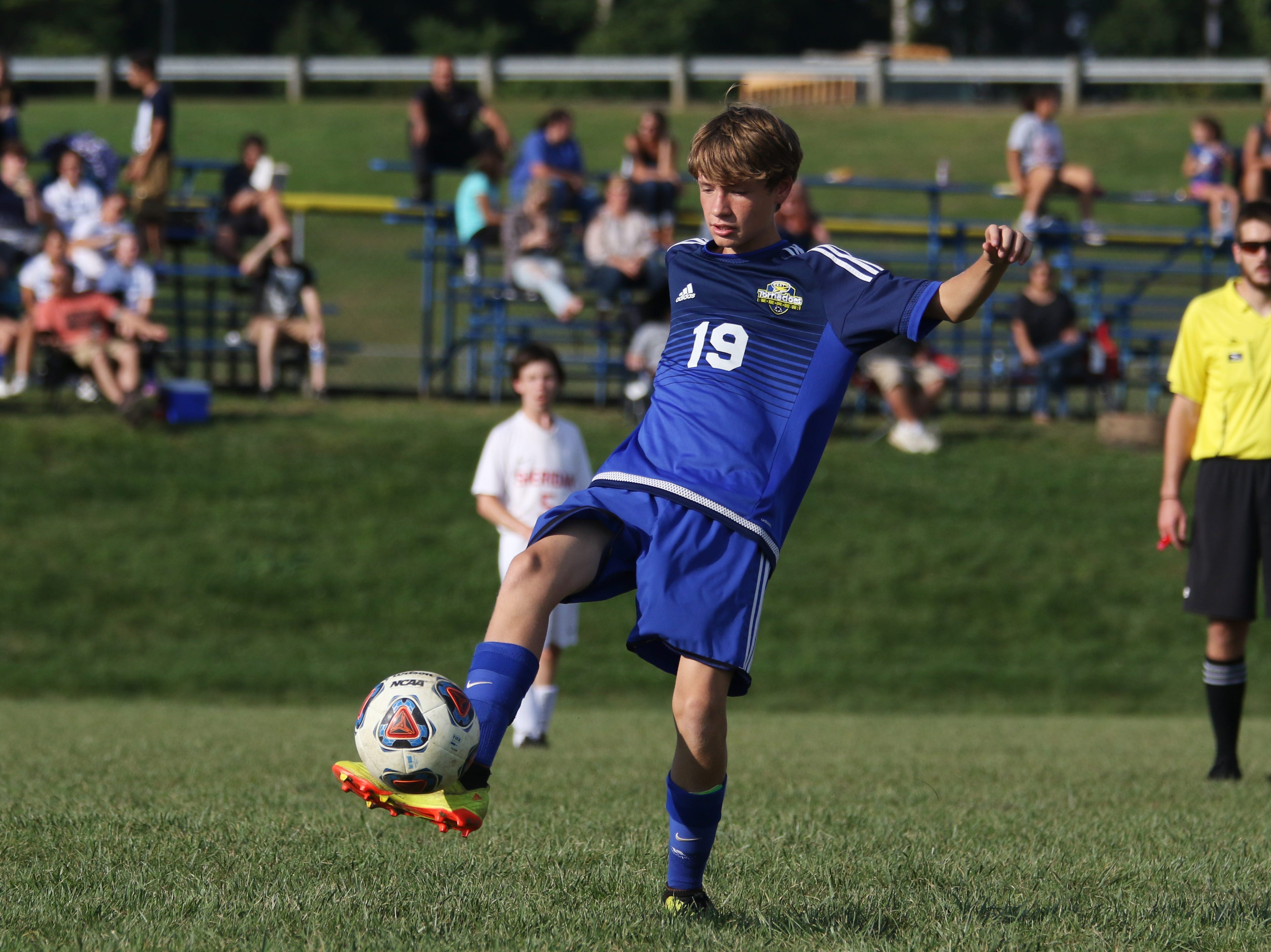 West Muskingum's Seath Collins controls the ball against Sheridan.