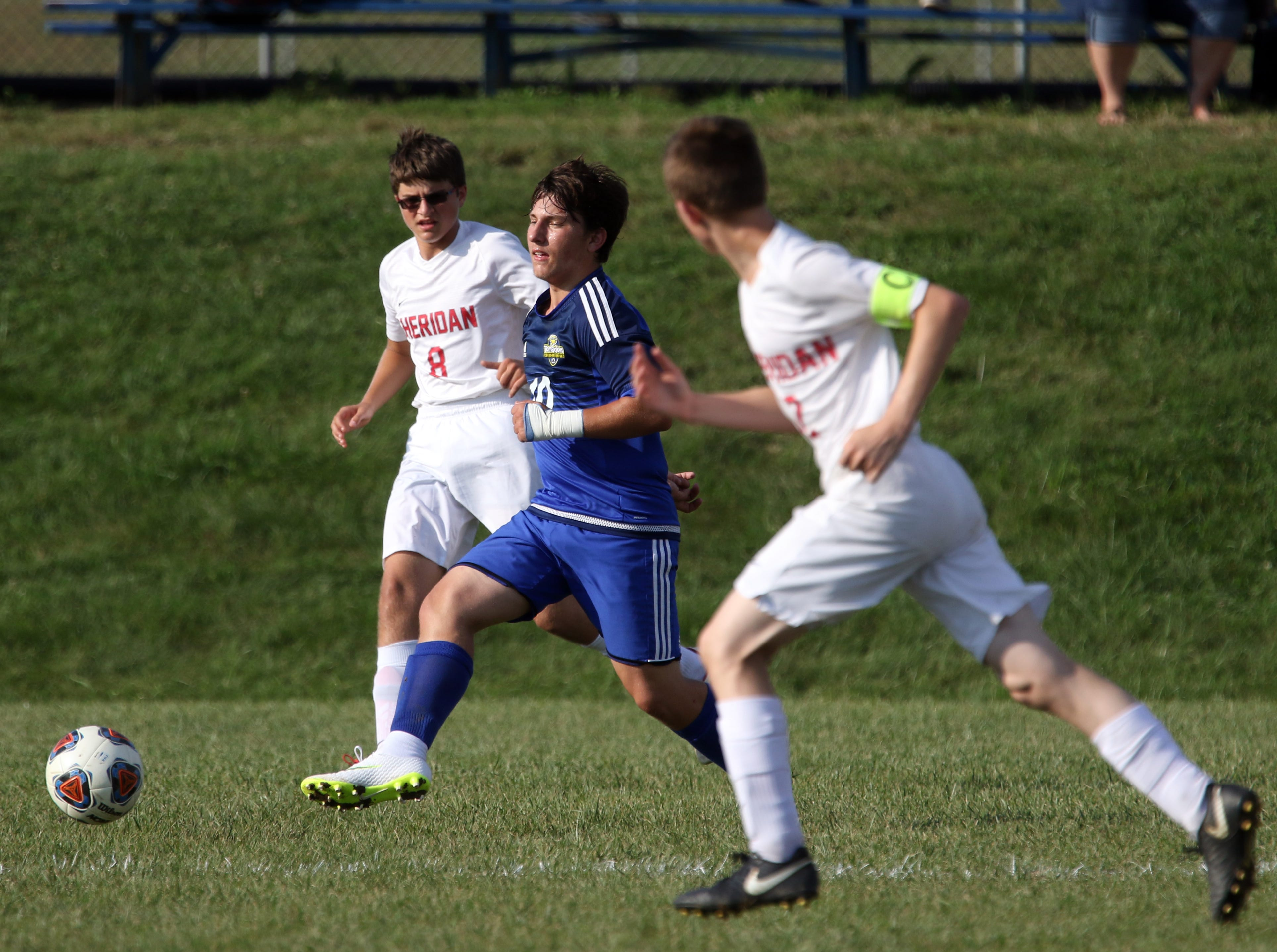 West Muskingum's Karson Dennis moves with the ball against Sheridan.