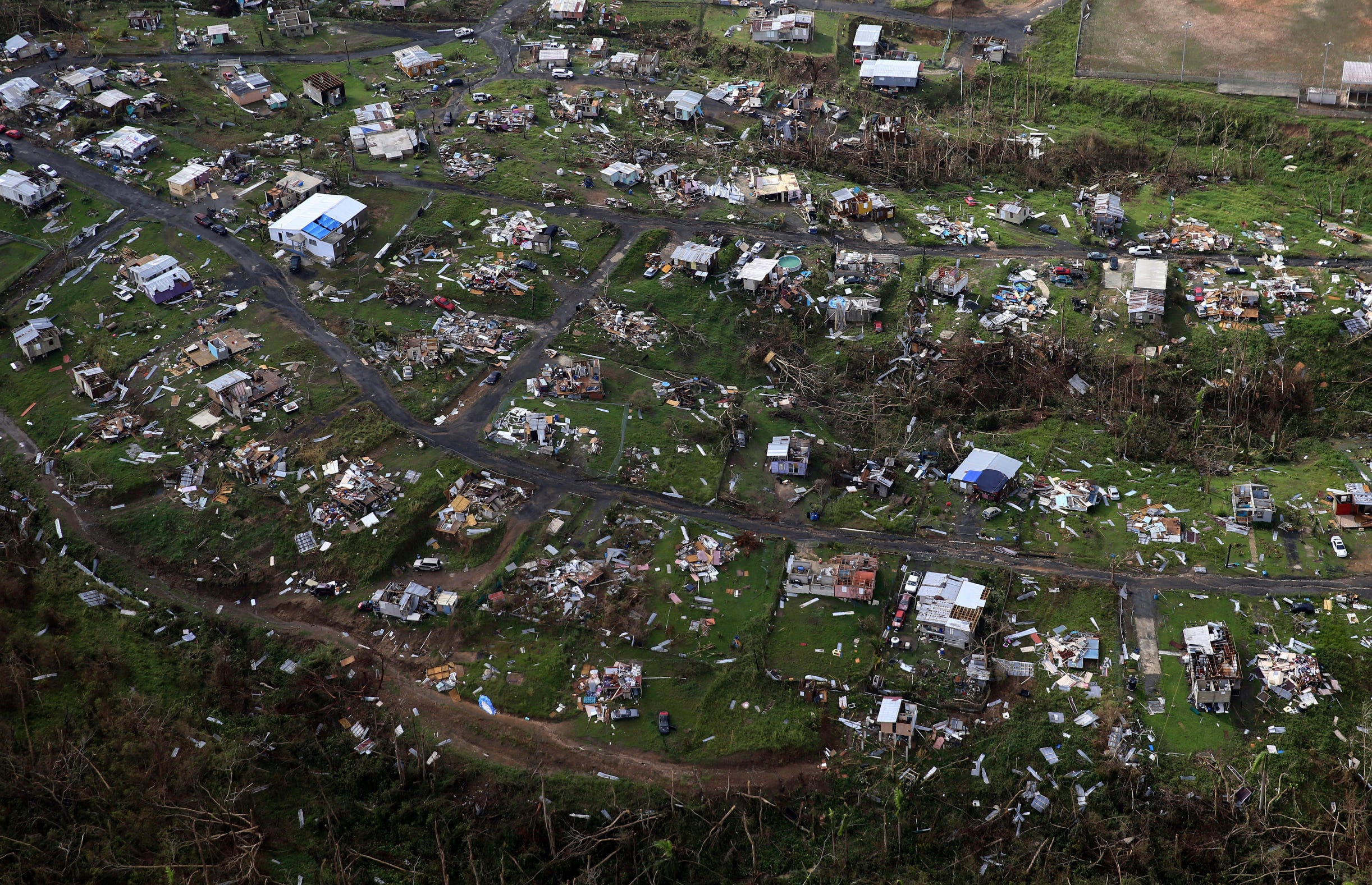 Homes and other buildings destroyed by Hurricane Maria lie in ruins in Toa Alta, Puerto Rico, on Sept. 28, 2017.