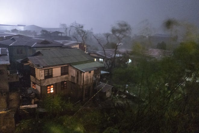 Rains cover the city as strong winds batter houses and buildings lying on the path of Typhoon Mangkhut as it makes landfall on September 15, 2018 in Tuguegarao city, northern Philippines.