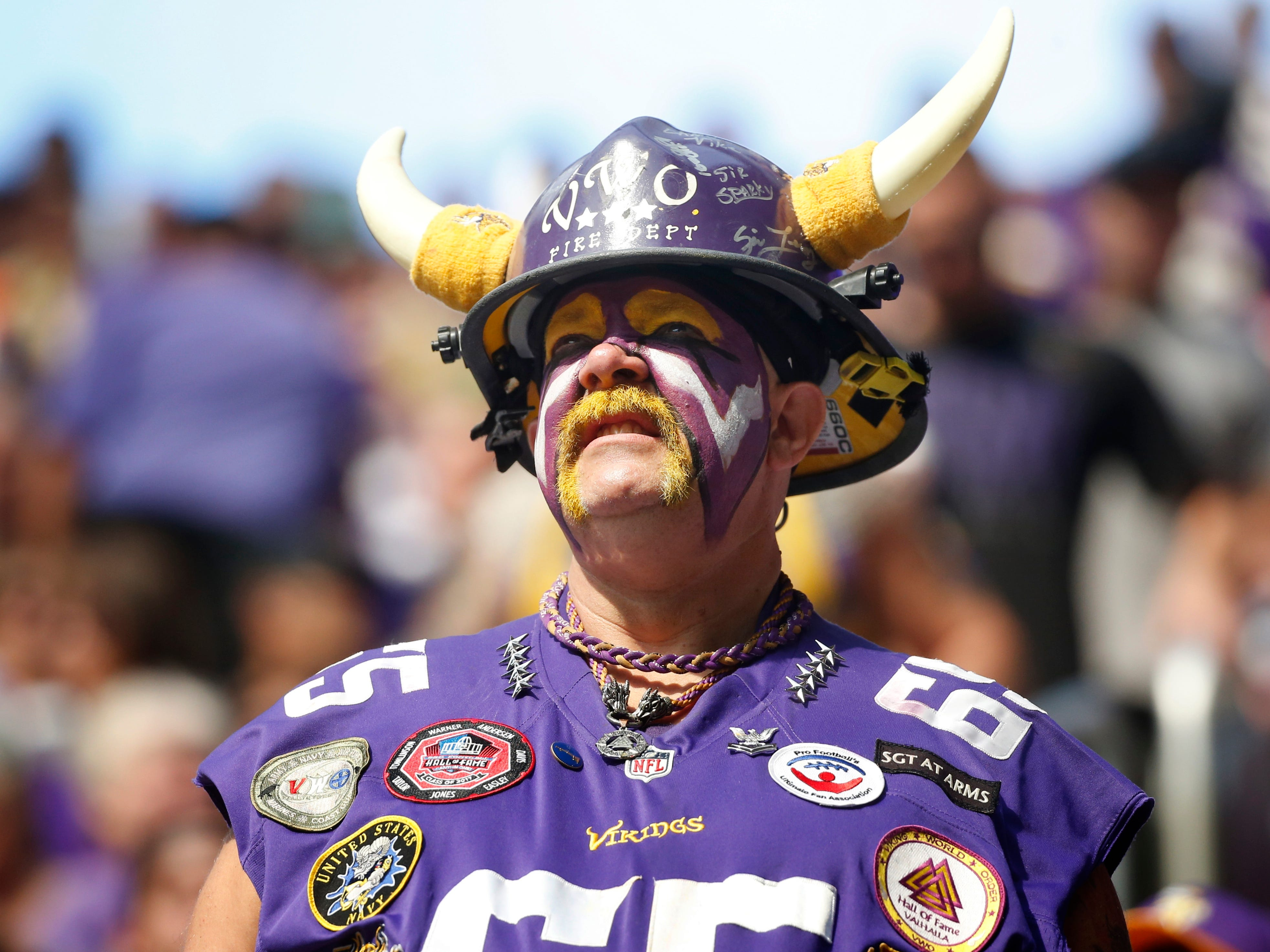 A Minnesota Vikings fan watches from the stands during the first half against the San Francisco 49ers.