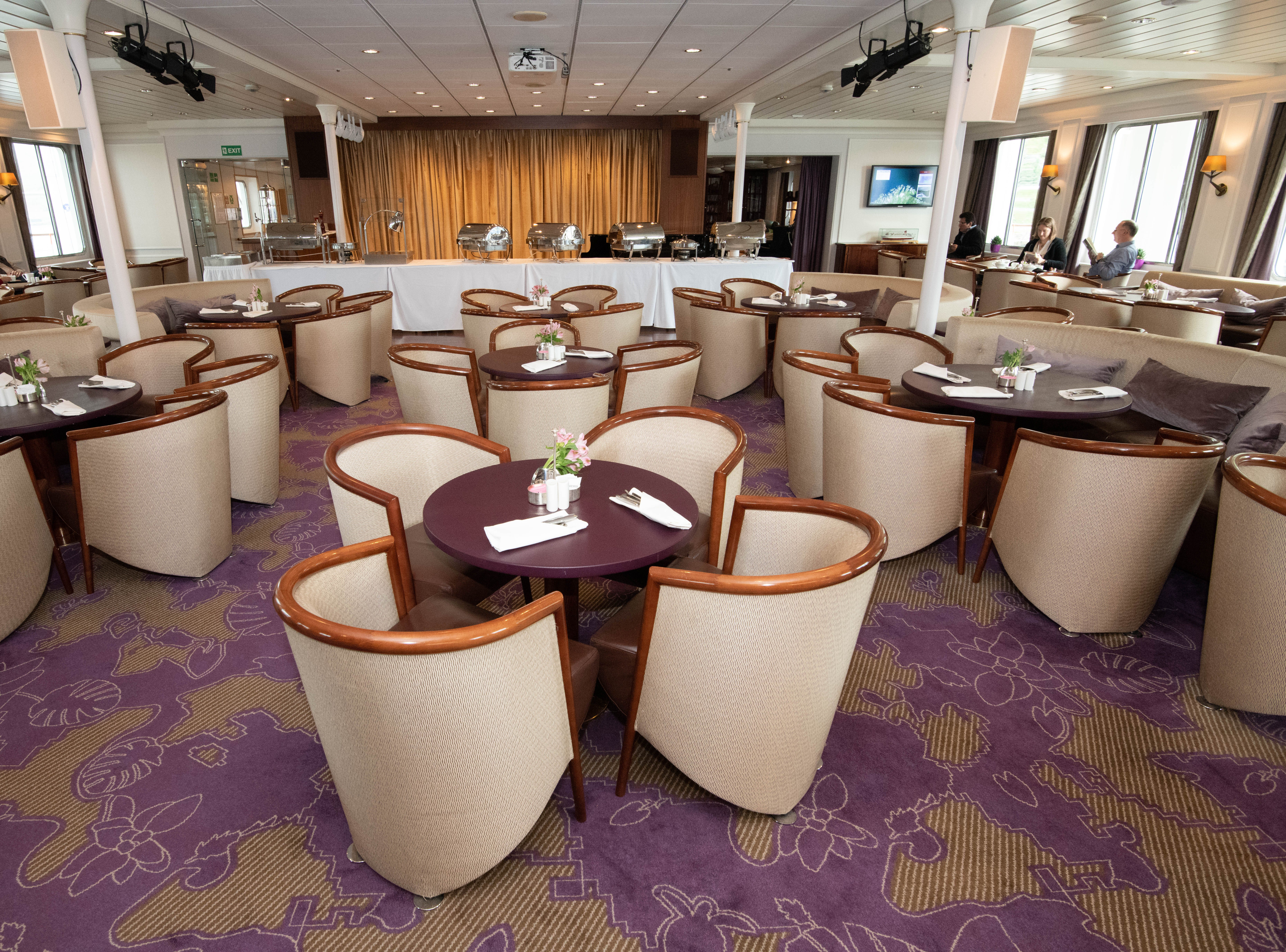 The Bremen Club lounge was designed with 149 seats, just about enough to hold every passenger on the ship at once.