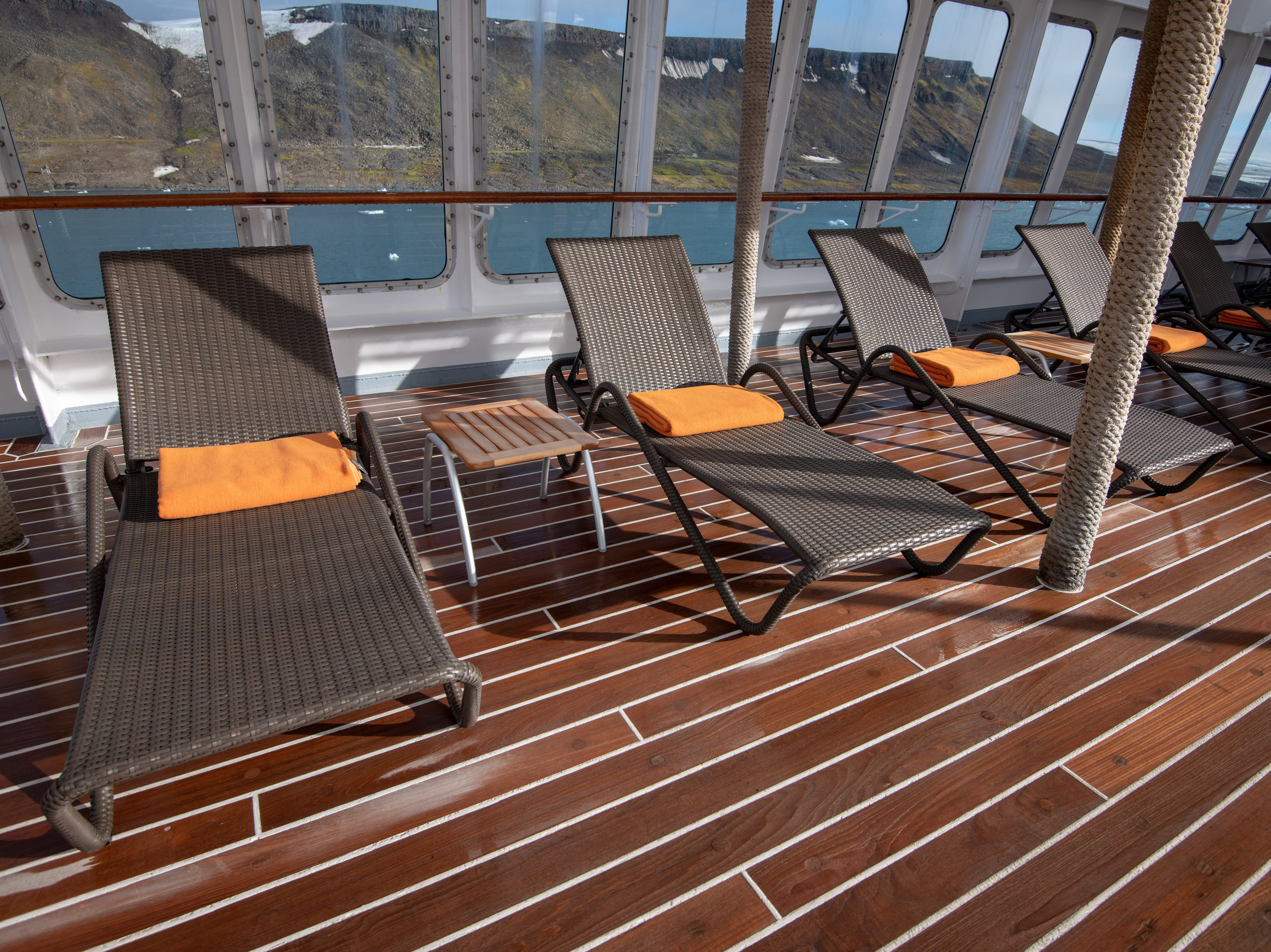 Lounge chairs line the sides of Bremen's Sun Deck, shaded under awnings.