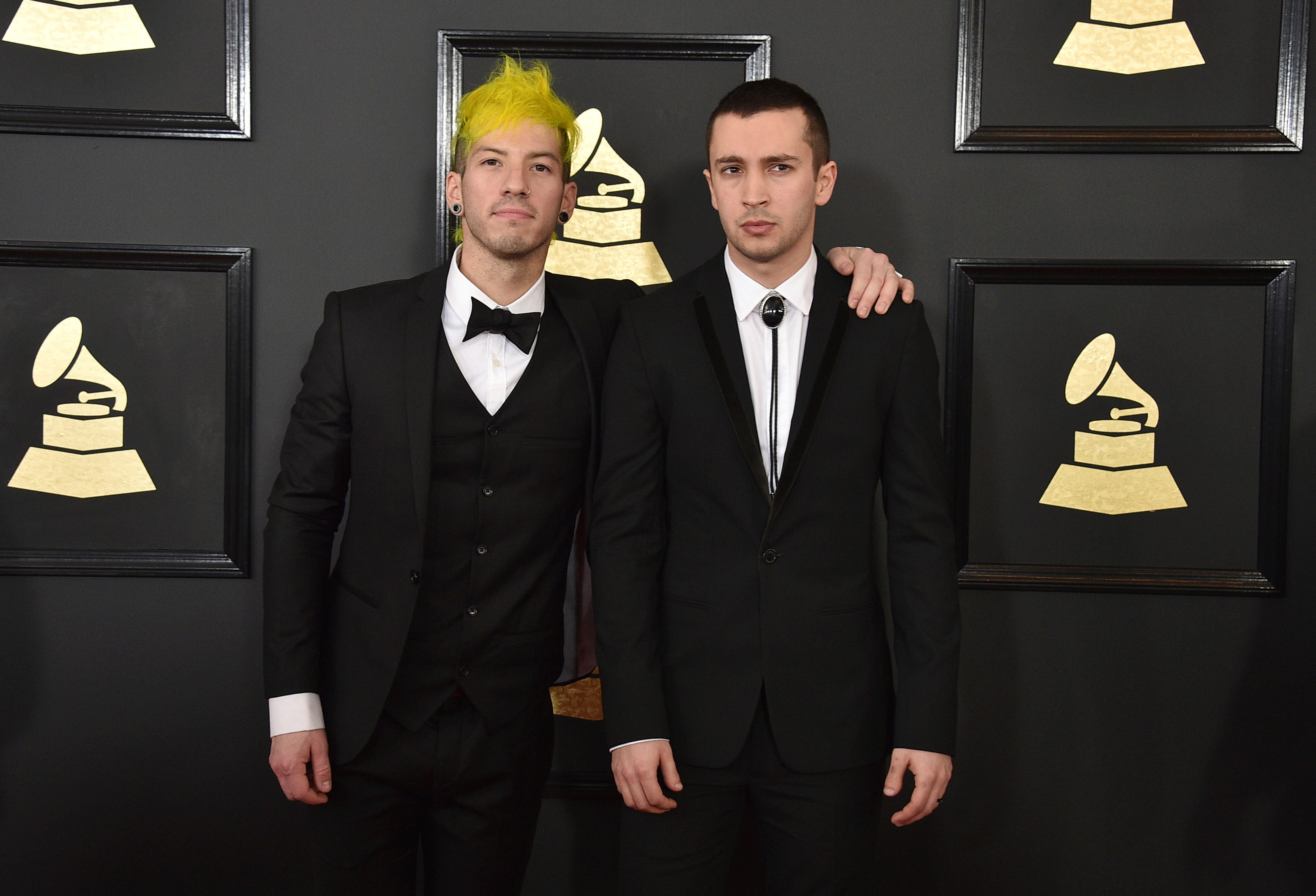 Josh Dun, left, and Tyler Joseph of the musical group Twenty One Pilots arrive at the 59th annual Grammy Awards at the Staples Center on Sunday, Feb. 12, 2017, in Los Angeles.