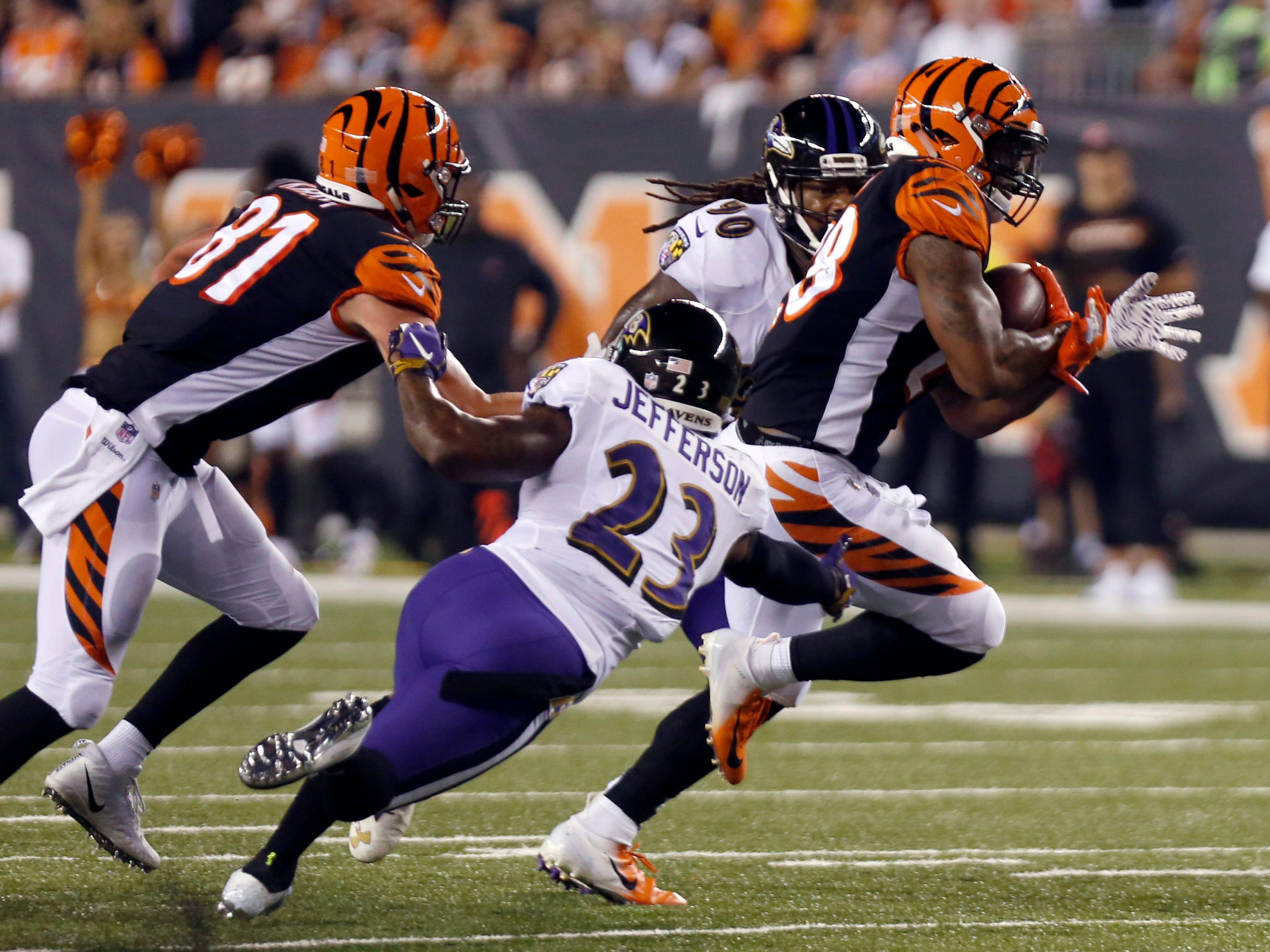 Bengals running back Joe Mixon runs against Ravens defensive back Tony Jefferson during the first half at Paul Brown Stadium.