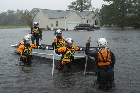 Members of the Federal Emergency Management Agency Urban Search and Rescue Task Force 4 from Oakland, California, search a flooded neighborhood for evacuees during Hurricane Florence on Friday, Sept. 14, 2018 in Fairfield Harbour, North Carolina. Hurricane Florence made landfall in North Carolina as a Category 1 storm and flooding from the heavy rain is forcing hundreds of people to call for emergency rescues in the communities around New Bern, North Carolina, which sits at the confluence of the Neuse and Trent rivers.