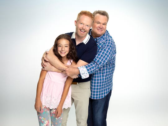 "Jesse Tyler Ferguson plays Mitchell Pritchett in ABC's ""Modern Family,"" along with Aubrey Anderson-Emmons as daughter Lily Tucker-Pritchett and Eric Stonestreet as husband Cameron Tucker."