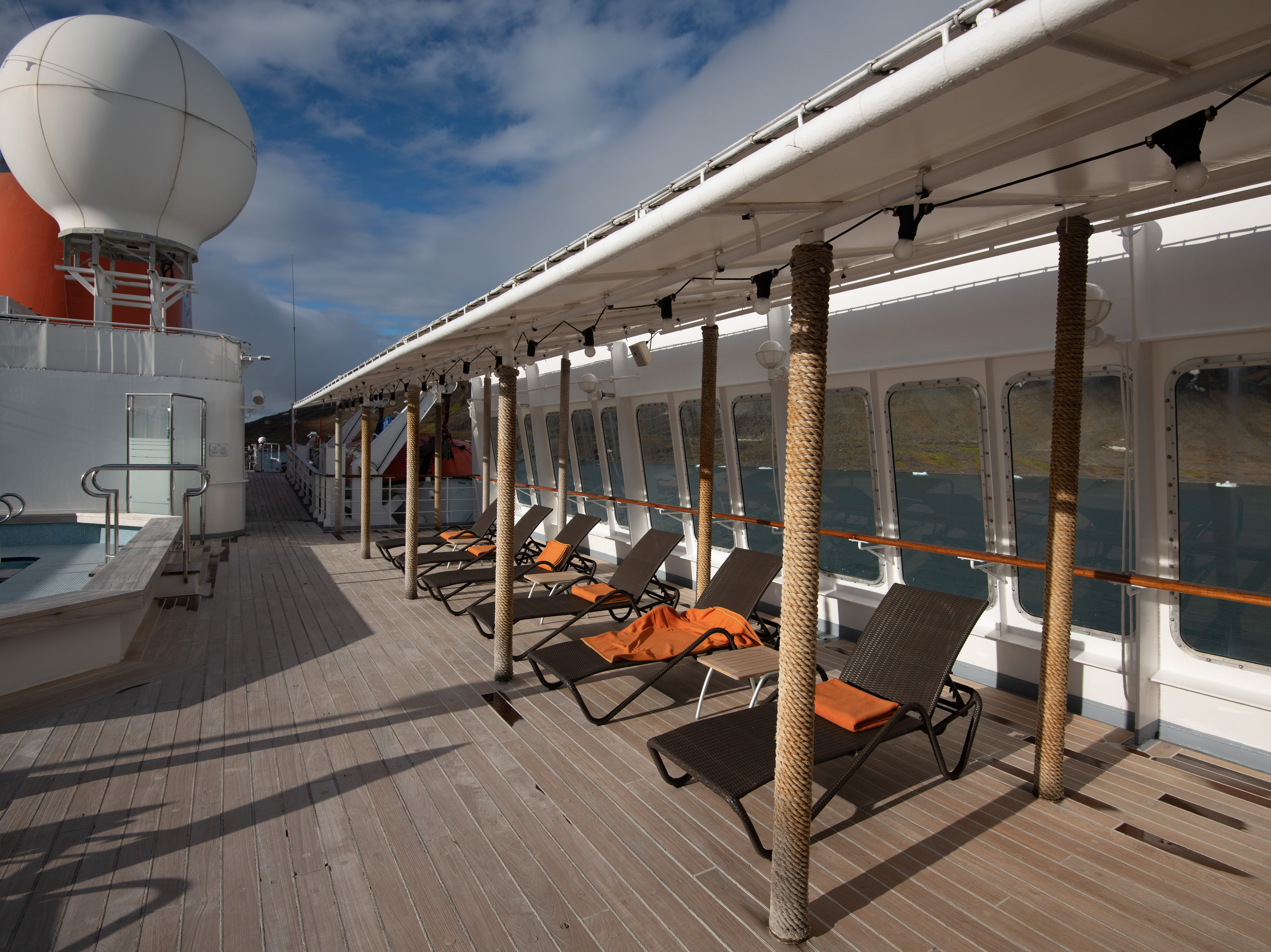An attendant places towels on the Sun Decks lounge chairs daily, even when Bremen is sailing in the frigid waters of the Arctic.