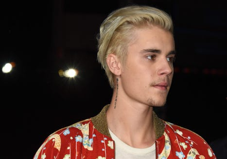 (FILES) A file photo taken on Fenruary 10, 2016, show singer Justin Bieber attending the Yves Saint Laurent men's fall line at the Hollywood Palladium in Hollywood, California. ROBYN BECK/AFP/Getty Images ORIG FILE ID: AFP_RO21B