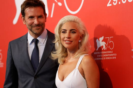 Lady Gaga and Bradley Cooper pose for photographers at the photo call for the film 'A Star Is Born' at the 75th edition of the Venice Film Festival in Venice, Italy, on Aug. 31, 2018.